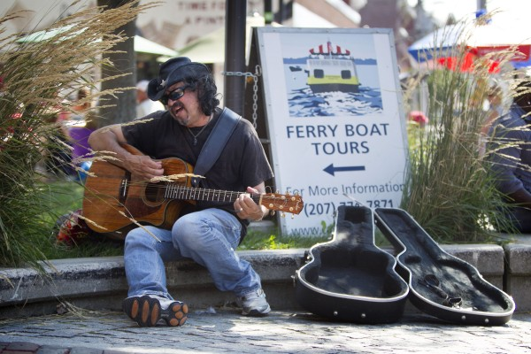Mark Cruz, 53, performs his blues/rock music near the Casco Bay Ferry terminal Sunday, Aug. 26, 2012, in Portland. Cruz is a former radio shock jock who has worked at stations across the country. He says he settled in Portland because it's an uncrowded city, even though he has been mugged here six times.