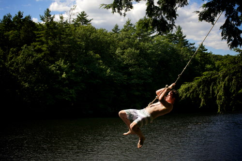 Brett Miller of Saco swings over the Saco River at Buxton's Pleasant Point on Monday, Aug. 6, 2012.