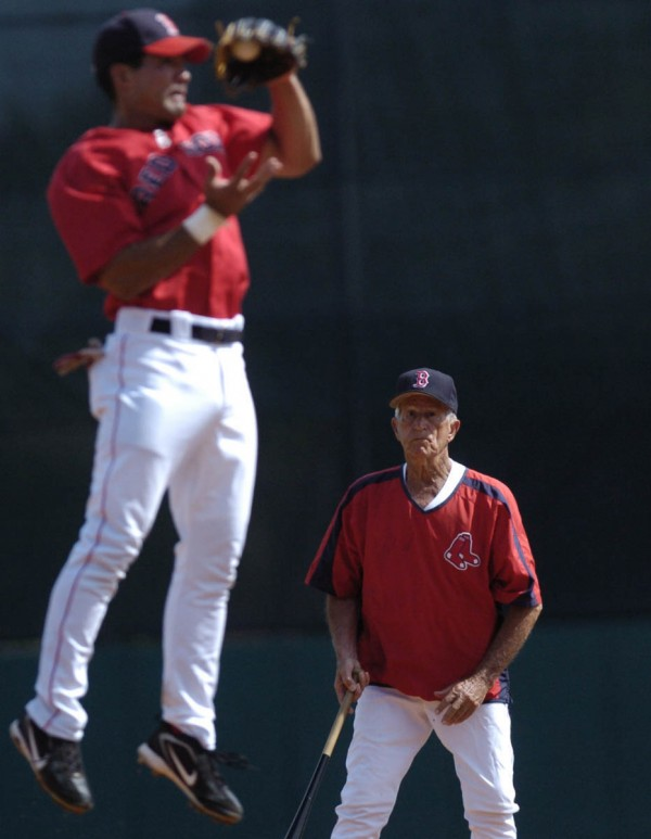 Johnny Pesky, former Red Sox player and coach and current consultant, watches Red Sox infielder Alejandro Machado make a catch during a Red Sox pre-game warm-up at City of Palms Park in Fort Myers, Fla., in March 2006.