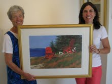 "Barbara Ernst Prey (right) shows Georges River Land Trust volunteer Jane Rasmussen her print ""Ladies in Red,"" sales of which will benefit the Land Trust."