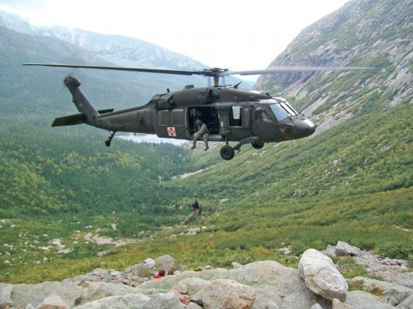 The crew of a Maine Army National Guard rescue Black Hawk helicopter lifts an injured hiker off a trail at the request of Baxter State Park officials in this undated photo. The Black Hawk's flight crew that day included Lt. Col. Mark Sullivan, Chief Warrant Officer 4 Jon Campbell, Staff Sgt. Mark Urquhart and Sgt. Carson Kelley.