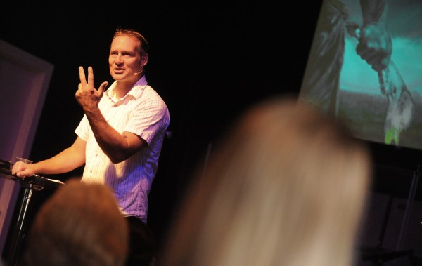Pastor Kirk Winters delivers the sermon to a packed house Sunday morning, Aug. 12, 2012.
