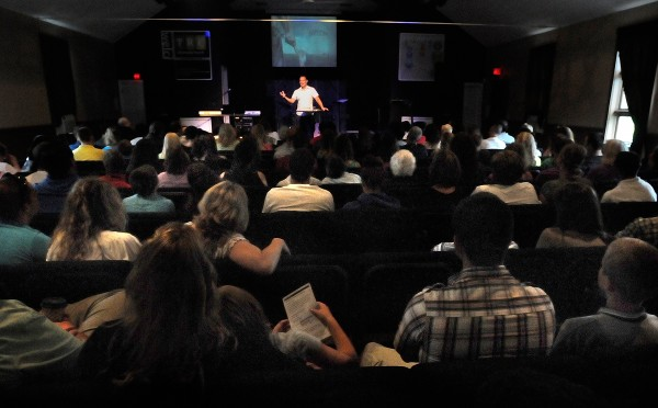 Pastor Kirk Winters (top center) delivers the sermon to a packed house Sunday morning, Aug. 12, 2012.