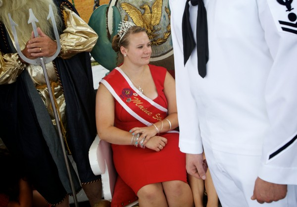 Kristen Sawyer, 2011Maine Sea Goddess, sits between King Neptune and a U.S. Navy sailor during a rehearsal for this year's pageant at the 65th annual Maine Lobster Festival in Rockland Wednesday, August 1, 2012.