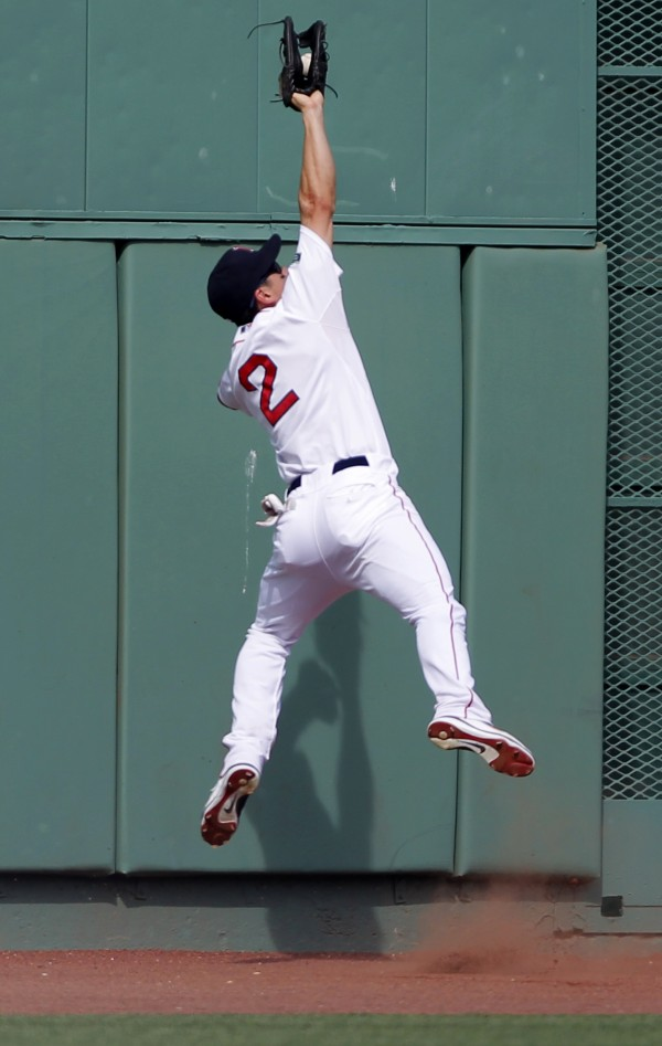 Boston Red Sox center fielder Jacoby Ellsbury catches a fly ball hit by Texas Rangers' Mitch Moreland off a pitch by Red Sox's Clayton Mortensen in the sixth inning of a baseball game at Fenway Park, in Boston, Wednesday, Aug. 8, 2012. The Rangers won 10-9.