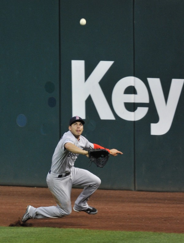 Boston Red Sox center fielder Jacoby Ellsbury makes a sliding catch on the warning track in the seventh inning of a baseball game against the Cleveland Indians, Saturday night Aug. 11, 2012, in Cleveland.