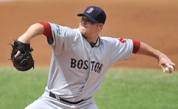 Boston Red Sox starting pitcher Jon Lester delivers against the Cleveland Indians in the second inning of a baseball game on Sunday, Aug. 12, 2012, in Cleveland.