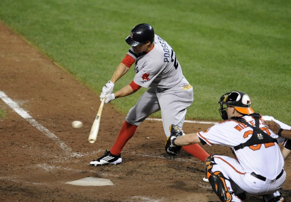 Boston Red Sox's Scott Podsednik (26) hits for a double during the sixth inning of a baseball game against the Baltimore Orioles, Thursday, Aug. 16, 2012, in Baltimore. The Red Sox won 6-3.
