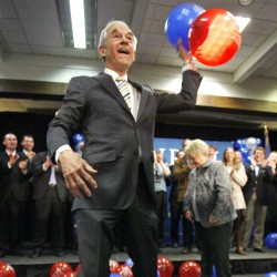 Republican presidential candidate Rep. Ron Paul, R-Texas, throws balloons from the stage after speaking to supporters in Portland following his loss in the Maine caucus in February 2012.