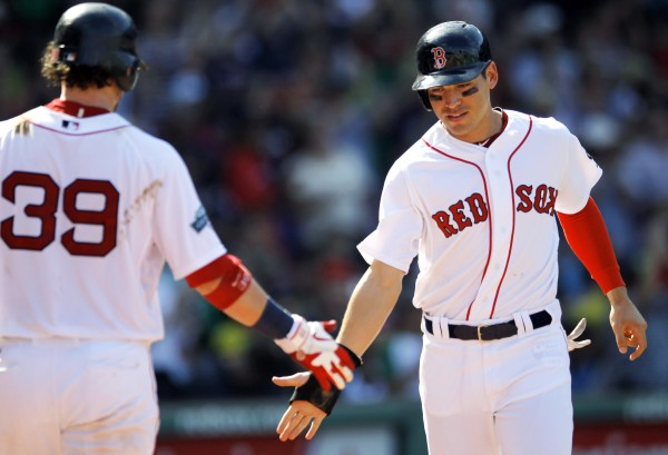 Boston Red Sox's Jacoby Ellsbury, right, celebrates with Jarrod Saltalamacchia, left, as he scores on a double hit by Cody Ross in the sixth inning of a baseball game against the Kansas City Royals at Fenway Park, Monday, Aug. 27, 2012, in Boston. The Red Sox won 5-1.