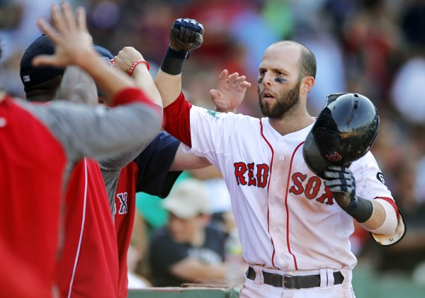 Boston Red Sox's Dustin Pedroia is welcomed to the dugout after hitting a home run off a pitch by Kansas City Royals' Louis Coleman in the eighth inning of a baseball game at Fenway Park in Boston, Sunday, Aug. 26, 2012. The Red Sox won 8-6.
