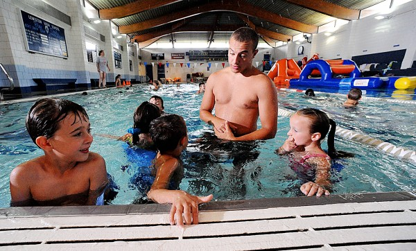 Lisbon Recreation Department camp counselor Tobey Harrington talks to camp-goers during their swimming lessons at the YWCA in Lewiston on Thursday. &quotWe have done much outreach with other rec departments and groups, and that has helped our bottom line a lot,&quot Executive Director Kathy Durgin-Leighton said.