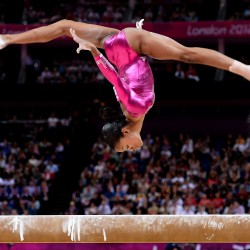 Gabrielle Douglas of the United States competes on the beam on her way to winning gold in the women's individual all-around gymastics competition during the 2012 Summer Olympic Games in London, England, on Thursday, August 2, 2012.