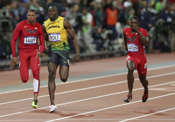 Jamaica's Usain Bolt leads USA's Ryan Bailey, left, and USA's Justin Gatlin in the men's 100m sprint during the Summer Olympic Games on Sunday, August 5, 2012, in London, England.