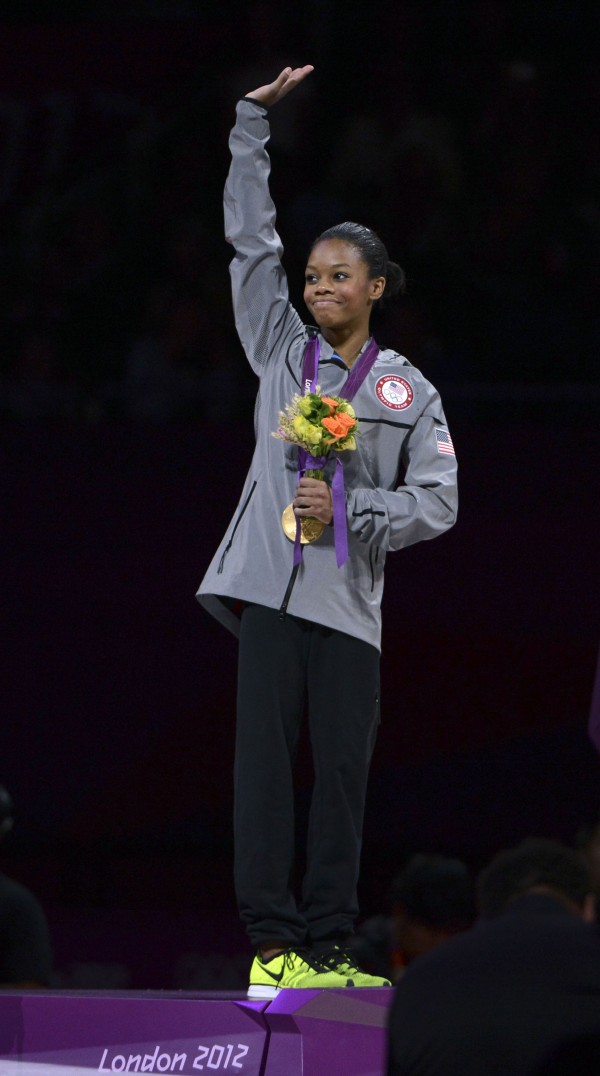 USA's Gabrielle Douglas waves to the crowd after receiving her gold medal for winning the women's individual all-around finals at North Greenwich Arena.
