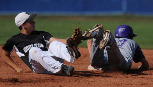 Houlton's Dan Howe (left) loses track of the ball as Hampden's Cody Varney dives over him to land safely on second base during first-ining action on Saturday, Aug. 4, 2012 during District 3 tournament action against Houlton at Mansfield Stadium in Bangor.