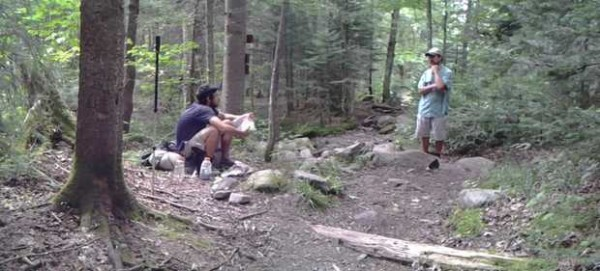 ppalachian Trail thru-hiker Stephanos Calligas, of Sudbury, Mass., stops for some lunch and conversation with Stephen Masse, the Maine Appalachian Trail Club caretaker at the Piazza Rock shelter and camping area in Sandy River Plantation.