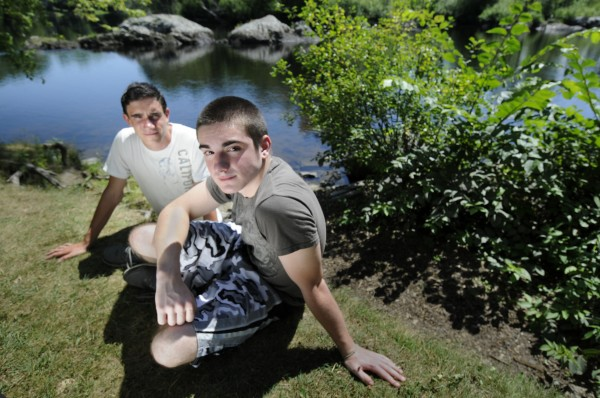 Tyler Jewett (front) and Anton Klose, both 16 and both rising juniors at Orono High School, risked their lives Monday, Aug. 8, 2012 to save a couple swimming in the Stillwater River behind Orono's Webster Park. They are shown on Wednesday, Aug. 8, 2012 in front of the swim spot where they rescued the couple.