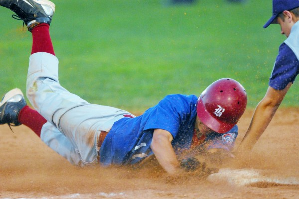 Bangor's Jon Stanhope (11) is tagged out on a close play at third by Hampden's Cody Lyons in first-inning action of the District 3 Senior League all-star tourney at Mansfield Stadium in Bangor Tuesday night Aug. 7, 2012.