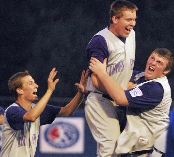 Hampden's Matt Closson (from left), Matt Palmer and Cam Prescott celebrate after defeating Bangor to clinch the District 3 title at Mansfield Stadium in Bangor on Thursday, Aug. 9, 2012.