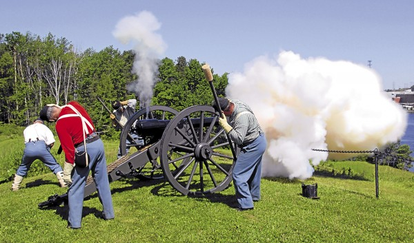 Thunder rolls across the Penobscot River as Civil War re-enactors with the Sixth Maine Battery fire a 10-pound Parrott gun at Fort Knox earlier this summer. The full-size cannon was built in Maine.