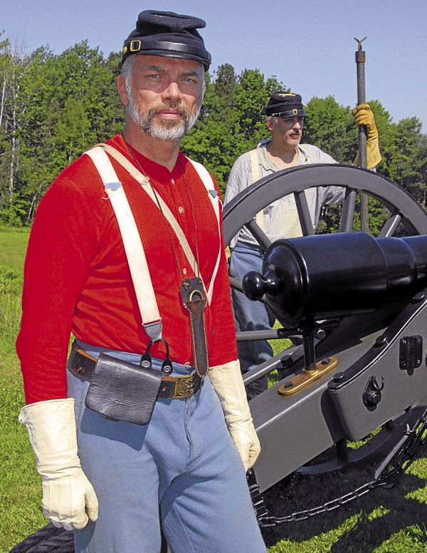 Among the Civil War re-enactors manning a Sixth Maine Battery cannon at Fort Knox are Peter Knowles of Charlotte (left) and Ben Trudel of Old Town.