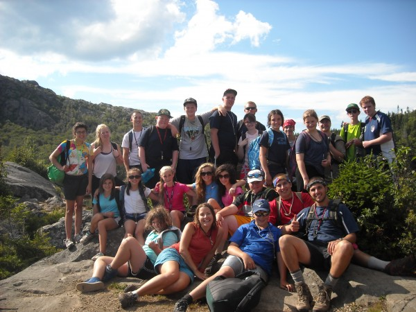 Trekkers' Team Puma students and their mentors pose at the top of Tumbledown Mountain in Mt. Blue State Park.