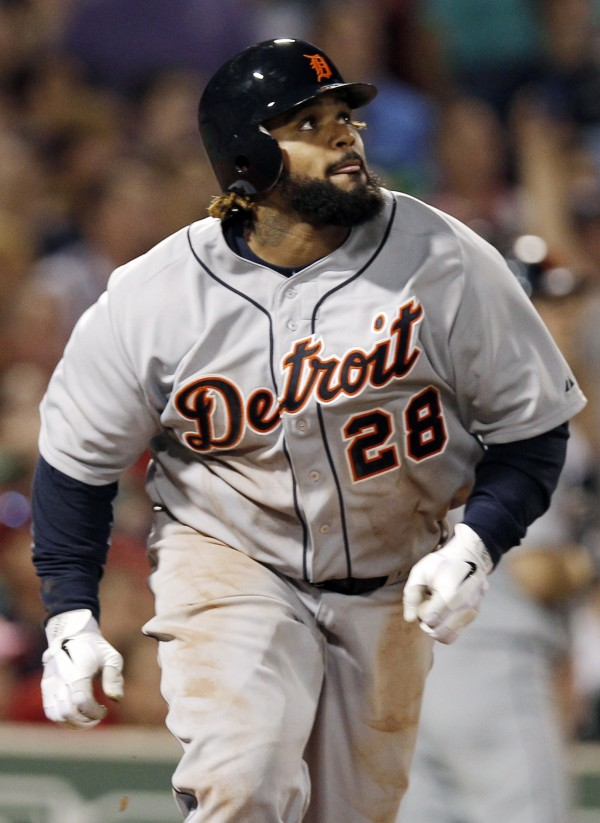 Detroit Tigers' Prince Fielder watches his home run against the Boston Red Sox during the fifth inning of a baseball game at Fenway Park in Boston, Wednesday night, Aug. 1, 2012. (AP Photo/Winslow Townson)