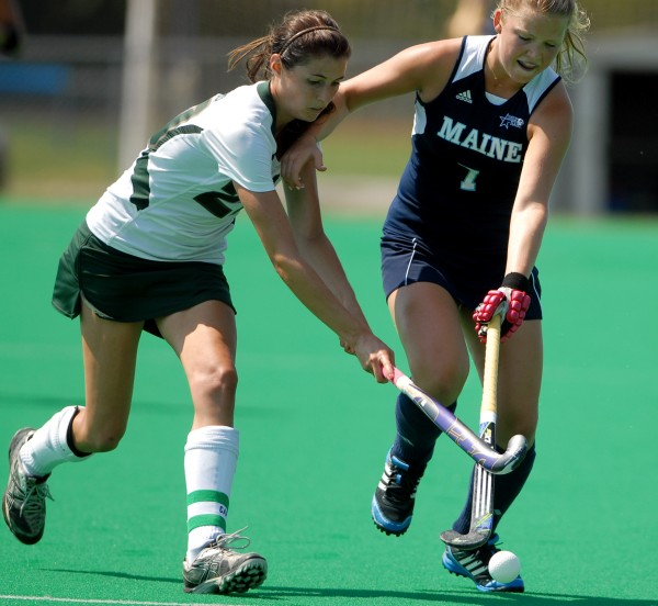 University of Maine's Elke Jacobse battles Michigan State's Kristen Henn for control of the ball in the second half of Sunday afternoon's field hockey game at the University of Maine Field Hockey Complex.
