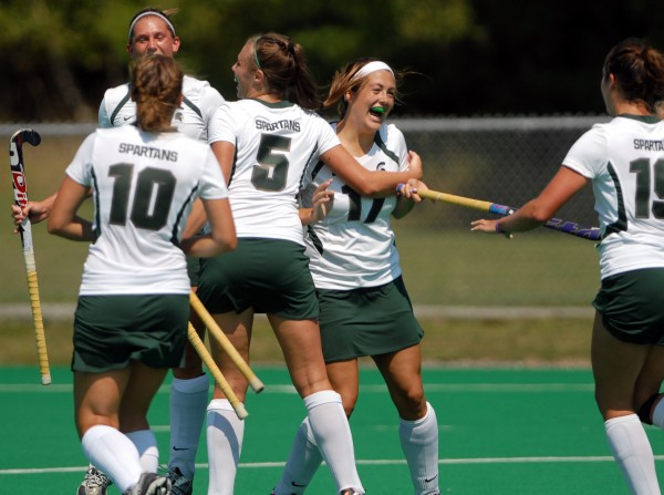 Michigan State celebrates the first goal of the game scored by Allie Ahern (17) against the University of Maine Sunday in Orono.