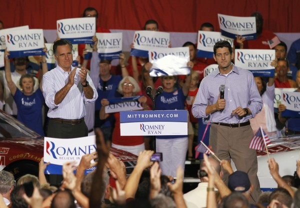 Republican vice presidential candidate Rep. Paul Ryan of Wisconsin (right) speaks during a campaign rally with Republican presidential candidate Mitt Romney (left) at the NASCAR Technical Institute in Mooresville, North Carolina, on Sunday, August 12, 2012.