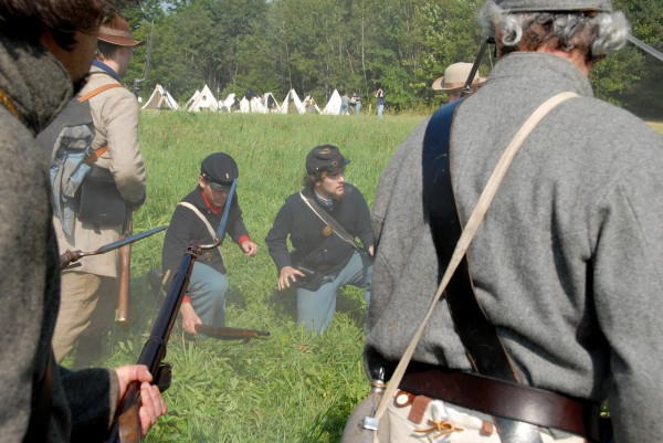 Union soldiers Ryan Middleton (left) and Ben Custer surrender after being surrounded and captured by Confederate soldiers at the &quotWe Are Coming, Father Abraham&quot Civil War encampment held at Good Will Hinckley School in Fairfield on Saturday, Aug. 25, 2012.