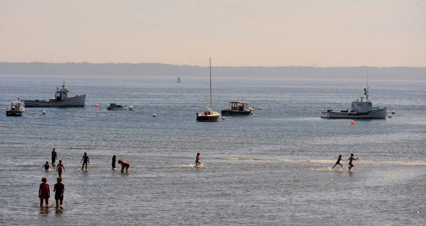 People enjoy the cool water and air at Lincolnville Beach on Wednesday, Aug. 8, 2012.  The temperature even along the coast was in the low 80s.