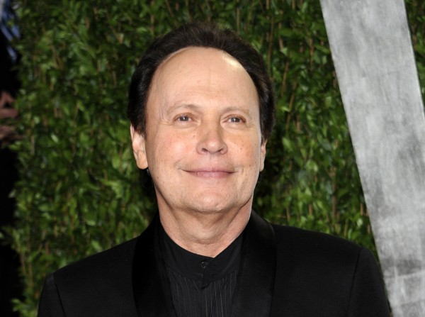 This Feb. 26, 2012 file photo shows Billy Crystal arriving at the Vanity Fair Oscar party in West Hollywood, Calif. Crystal has an agreement with Henry Holt and Company for a book that will be part memoir, part meditation, with jokes, about getting older.