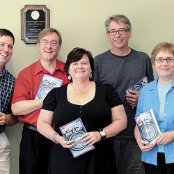 "Contributors to the local anthology ""A Quiet Blue Wheel"" pose with copies of their book. From left: David M. Fitzpatrick, class instructor and editor; Christopher Olsen; Kelly Jean Richardson; Greg Westrich; Anette Ruppel Rodrigues; and Paula Burnett. Not pictured: Charles O'Leary, Marsha Libby, and Amanda and Josh Updegraff."