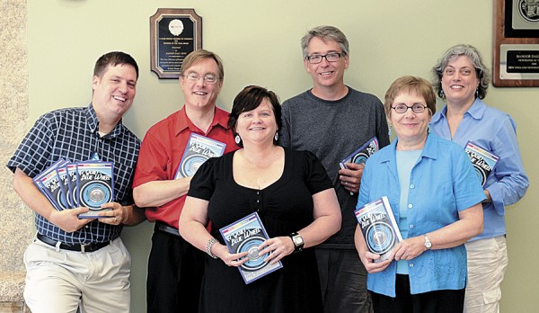 Contributors to the local anthology &quotA Quiet Blue Wheel&quot pose with copies of their book. From left: David M. Fitzpatrick, class instructor and editor; Christopher Olsen; Kelly Jean Richardson; Greg Westrich; Anette Ruppel Rodrigues; and Paula Burnett. Not pictured: Charles O'Leary, Marsha Libby, and Amanda and Josh Updegraff.