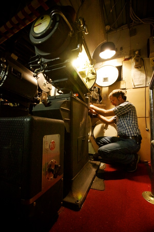 Jason Sheckley, owner and projectionist at the Harbor Theatre in Boothbay Harbor, gets his antique, carbon arc equipment ready for the evening May 28, 2012. The one-screen movie house must soon convert to digital projectors or face closing down for good.