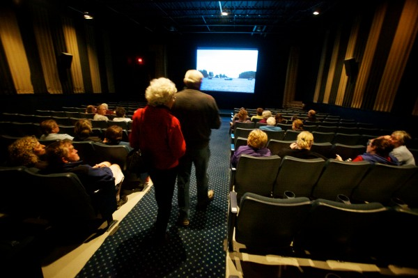 Patrons file into the auditorium at the Harbor Theatre in Boothbay Harbor May 28, 2012. The one-screen movie house must soon convert to digital projectors or face closing down for good.
