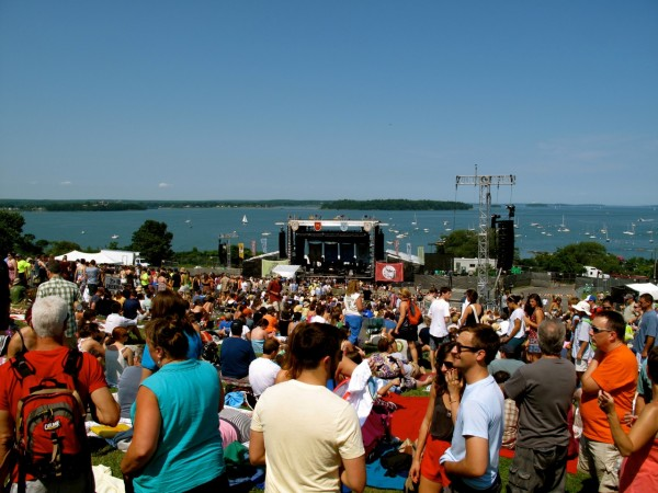 Crowd waiting for the next act on the main stage, with Casco Bay as a backdrop