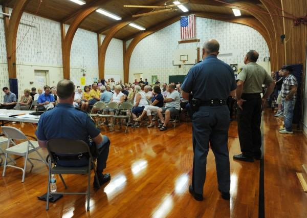 Maine State Police Sgt. Ted Millett (left), Lt. Wesley Hussey (center) and Penobscot County Sheriff Glenn Ross (right) listen as concerned Howland residents strongly voice concerns about what they called &quotpunks: causing havoc in town.