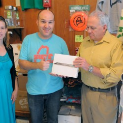 Zeth Lundy (second from left), co-owner of Central Street Farmhouse in Bangor, was the winner of the iPad from the Bangor Daily News. Over 600 people entered during the American Folk Festival to win the device. Pictured with Lundy representing the Bangor Daily News are Aimee Thibodeau (left), Shelley Sund (right) and Towle Tompkins.