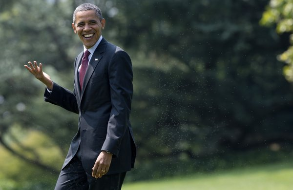 US President Barack Obama gestures as a reporter shouts a question during his walk to Marine One prior to departing from the South Lawn of the White House in Washington, DC, August 2, 2012. Obama is traveling to Florida and Virginia to attend campaign events.