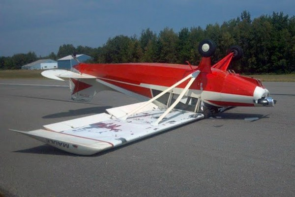 Two men suffered slight injuries when this airplane flipped over after a landing at the Lincoln Regional Airport on Thursday, Aug. 9, 2012.