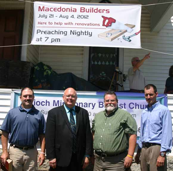 Antioch Baptist Church Pastor George Dever (second from left) stands with Macedonia Builders Curtis Rodenbacker (from left) of Clarksville, Tenn., Paul Lamb of Ackworth, Ga., and Brant Lane of Somerset, Ky., during their two-week stay in renovating the former Dexter Methodist Church.