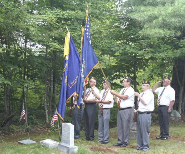 The color guard from American Legion Post 41 in Milo stands at attention during the rededication ceremony for the grave site of Lauren Cowallis at a Lyford Road cemetery in Orneville on Aug. 15. Cowallis was killed in action in December 1944 when his B-26 was shot down over Europe, and the stone honoring the man who gave his life for his country has now been fully repaired to honor Cowallis and his sacrifice.