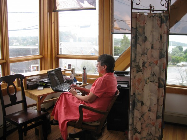 Jennifer Hill of Memorable Events works Friday afternoon in her nook at The Office, a cooperative work space in Belfast.