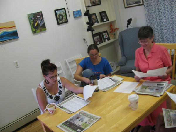 Graphic designer Lee Parent (left), writer Robin McCarthy and event planner Jennifer Hill decided to accept another member Friday morning during the monthly meeting for The Office cooperative workplace in downtown Belfast.