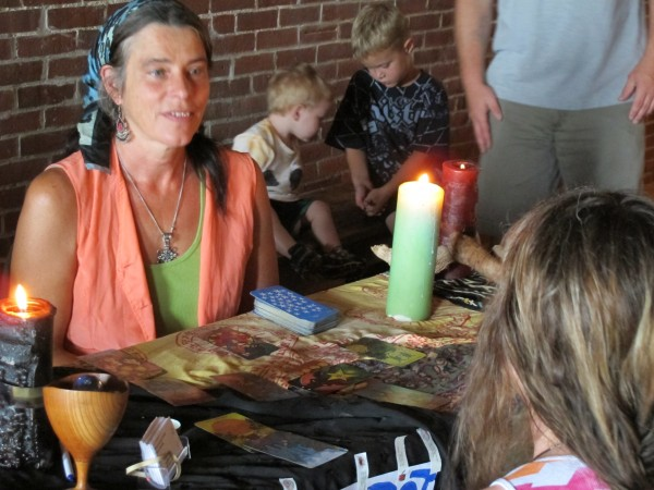 Rebecca Albright of Otis reads tarot cards during the Psychic and Paranormal Faire at Fort Knox in Prospect on Sunday, Aug. 12, 2012.