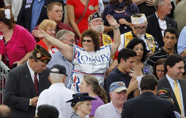 A supporter of Republican U.S. presidential candidate Mitt Romney dances in the crowd as she waits for Romney to introduce Rep. Paul Ryan as his vice-presidential running mate.