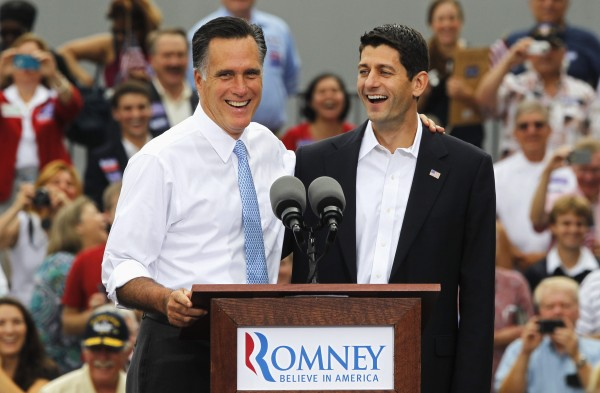 Republican presidential candidate Mitt Romney (left) introduces Rep. Paul Ryan as his vice presidential running mate during a campaign event at the retired battleship USS Wisconsin in Norfolk, Va., Aug. 11